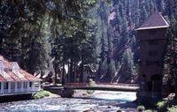 Wyntoon - Water house left, bridge, Stone tower right 7-75 Kushlis