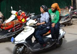 Kashgar girls on motorcycle