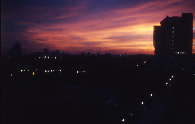 Bangkok - Night Sky & Dusit Thani on left from our apt 1974